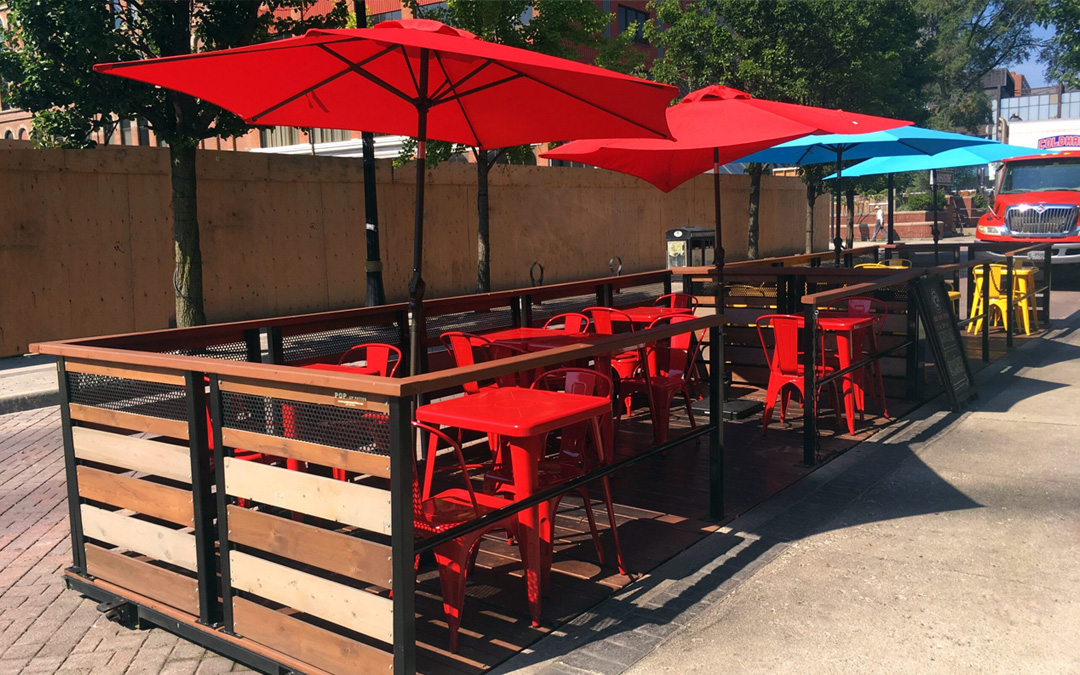 patented pop up street patio with umbrellas