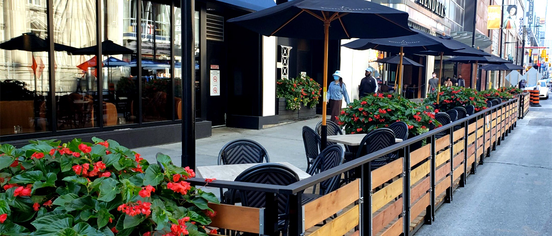 standard street patio example with rails and umbrellas