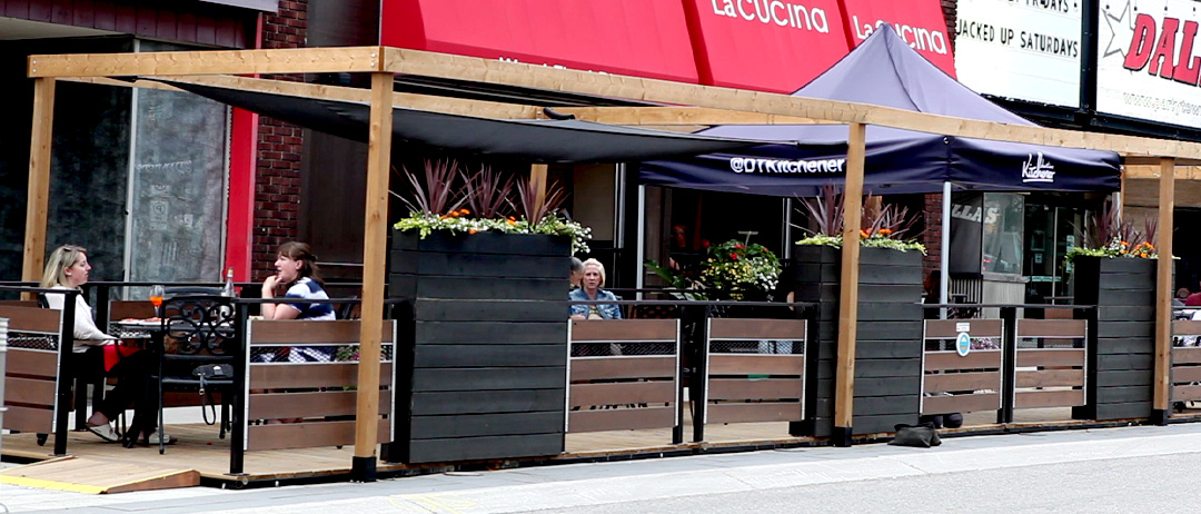 planter box wall example outside la cucina with high wooden blocks and plants on top
