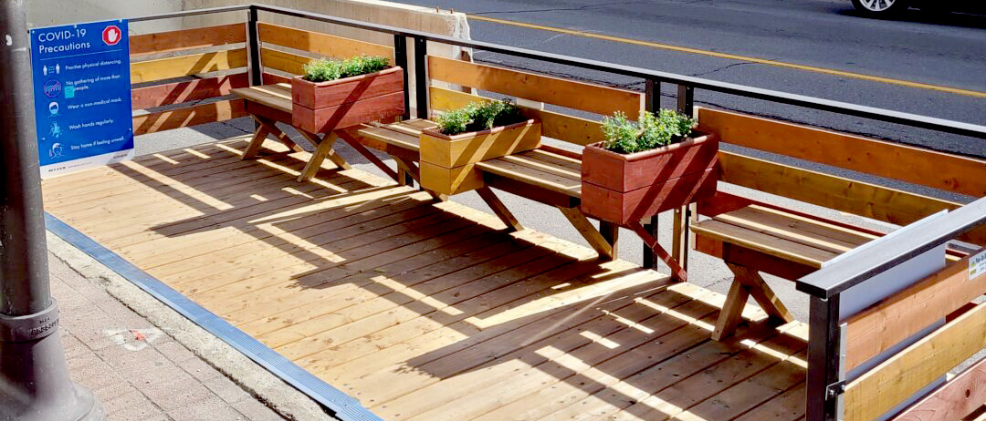 benches example with strips of benches and planter boxes in a street patio